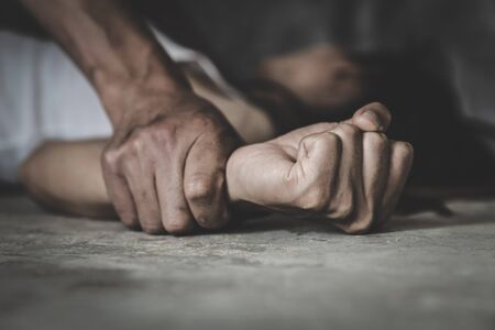Man's hand holding a woman hand for rape and sexual abuse concept, Wound domestic violence rape, concept photo of sexual assault, International Women's Day Banque d'images
