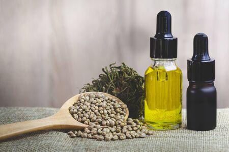 Hemp oil in a glass jar and hemp seeds, CBD cannabis OIL, natural herb, medical marijuana concept.