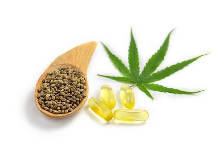 CBD cannabis oil. Hemp oil capsules and  hemp seed isolated on white background. medical marijuana concept. Фото со стока