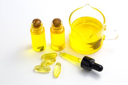 Hemp oil in a glass jar isolated on a white background, Pure cold pressed oils concept, CBD hemp oil.