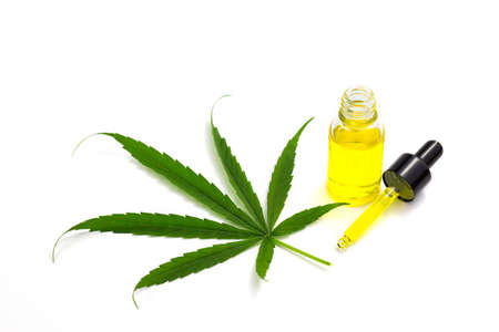 CBD hemp oil, Hemp oil extract in glass bottles , medical marijuana concept, on a white background, CBD oil pipette.