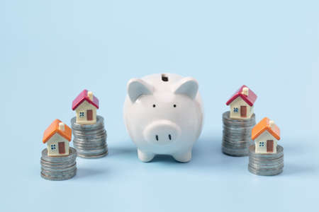 Piggy bank, concept of saving money for house, Savings money for buy house and loan to business investment for real estate concept. Invesment and Risk Management.