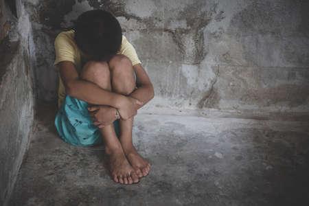 The girl sat depressed in a dark room, Violence against children, Domestic violence,  human trafficking  Concept, stop violence against Women, international women's day 版權商用圖片