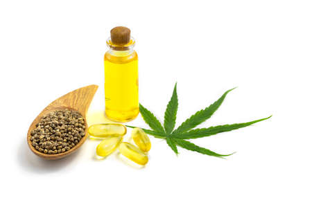 bottle with hemp oil, hemp leaf and seeds on white background, CBD oil hemp products, cannabis extract oil, Medical marijuana. 版權商用圖片
