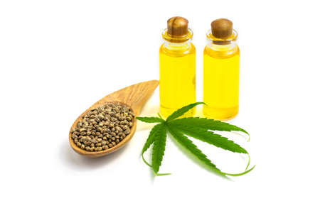 Hemp seeds and hemp oil on white background, CBD cannabis oil extract, marijuana  alternative herbal medicine concept.