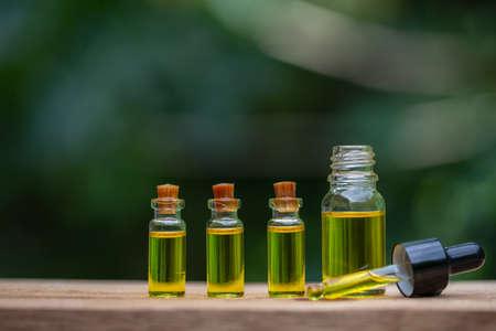 Glass bottles containing  hemp oil,  drugs extracted CBD Cannabis Oil  of researchers or medical team. Herbal alternative medicine. 版權商用圖片