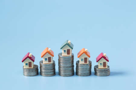 miniature houses among pile of coins, Housing industry mortgage plan and residential tax saving strategy, mortgage, investment, real estate and property concept 版權商用圖片 - 152257084