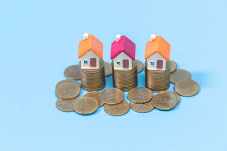 Miniature colorful house on stack coins, Finance and Investment concept and Real Estate Growth Interest. Imagens