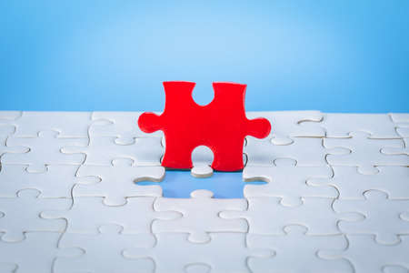 Jigsaw puzzle pieces on a blue background, Business solutions, success and strategy concept. Imagens