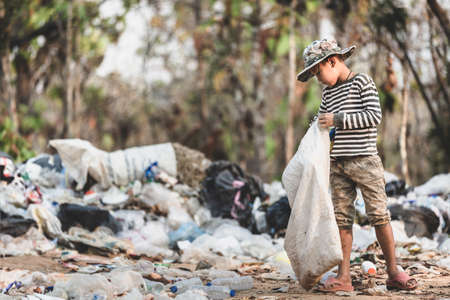 Poor children collect and sort waste for sale, concepts of poverty and the environment. Imagens