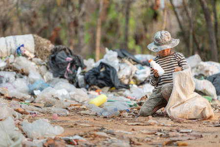 Poor children collect garbage for sale because of poverty, Junk recycle, Child labor, Poverty concept.