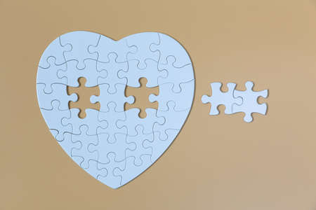 piece of  White jigsaw puzzle On the Yellow background . teamwork concept.  symbol of association and connection. business strategy. Standard-Bild
