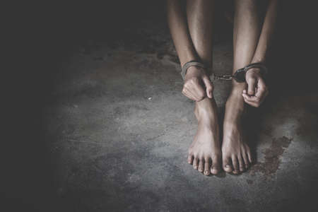woman hands in handcuffs, human trafficking Concept, stop violence against women, Human rights violations.