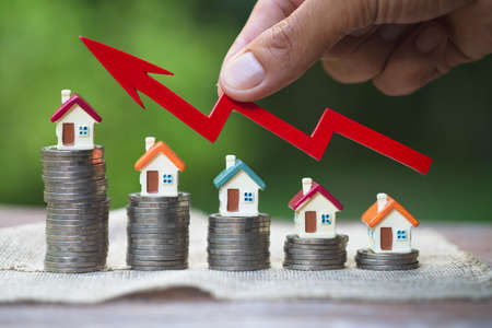 coins money setting growth up increase to house model for concept investment mortgage finance and home loan business,  innovation, growth and money.