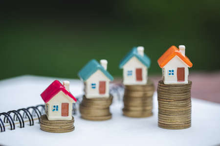 Miniature colorful house on stack coins, Finance and Investment concept and Real Estate Growth Interest. Reklamní fotografie