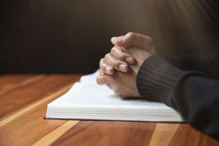 woman hands praying to god with the bible. Woman Pray for god blessing. Religious beliefs Christian life crisis prayer to god. 스톡 콘텐츠