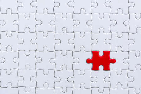 piece of Red and White jigsaw puzzle. teamwork concept.  symbol of association and connection. business strategy. 版權商用圖片