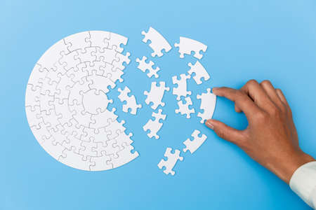 Pieces of jigsaw puzzle in man's hands, Business solutions, success and strategy concept.