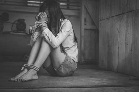 Victims of the human trafficking process tied to a rope.  Abused and tortured concept. Stop violence against Women. International women's Day. Stop abusing violence.