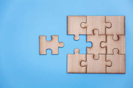 jigsaw puzzle pieces on blue background,  Business solutions, success and strategy, Business partnership concept. Copy space. 免版税图像