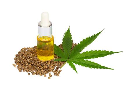 CBD cannabis oil. Hemp oil and  hemp seed isolated on white background. Healthy cannabis oil. 免版税图像