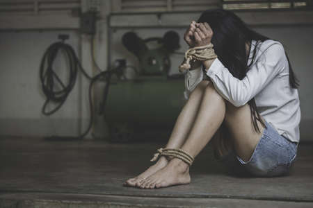 hopeless man hands tied together with rope, human trafficking, Stop abusing violence.