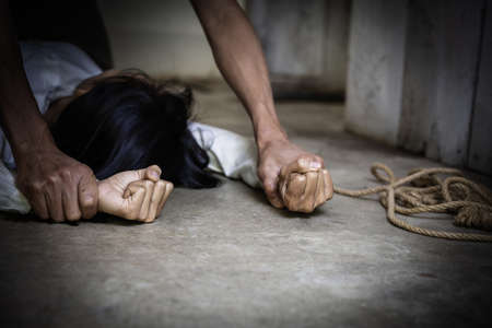Man hands holding a woman hands for rape and abuse concept. Young depressed woman, beaten and raped, Domestic violence. Copy space.