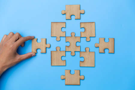 Hand connect jigsaw parts with word problem  solution.   symbol of association and connection. business strategy. Teamwork concept. 版權商用圖片