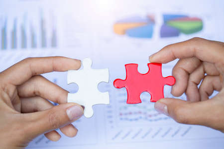 Human hands holding red jigsaw  with word problem & solution.  symbol of association and connection. business strategy.
