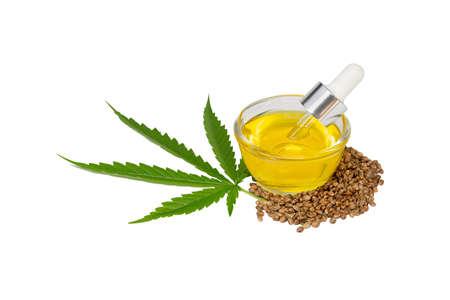 CBD cannabis oil. Hemp oil and  hemp seed isolated on white background. Healthy cannabis oil. 版權商用圖片
