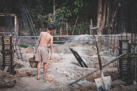 Poor children work in construction sites because of poverty, Child labor, human trafficking, World Day Against Child Labour concept.