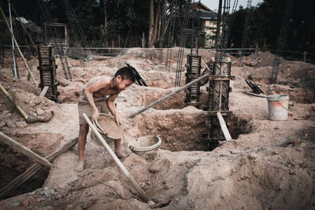 Children who work hard on the construction site, child labor , World Day Against Child Labour concept.