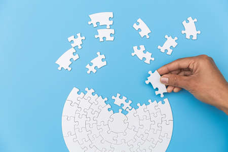 Jigsaw connection, Jigsaw puzzle in the hand of a businessman,  Business team assembling Jigsaw puzzle.