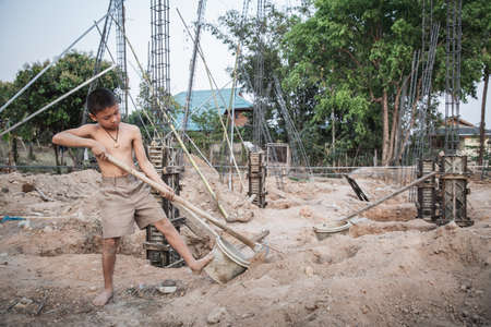 Poor children working in construction, Illegal child labor, Concepts of human trafficking and human rights
