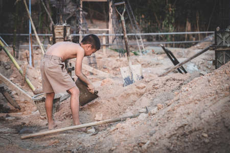 The concept of child labor, Poor children are forced to work in construction, Violence children and trafficking concept,  Rights Day,  World Day Against Child Labour concept Banque d'images