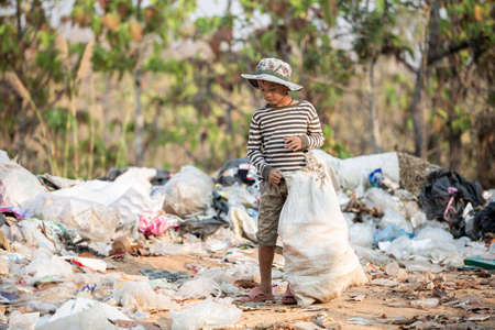 child walk to find junk for sale and recycle them in landfills, the lives and lifestyles of the poor, The concept poverty, child labor and human trafficking.