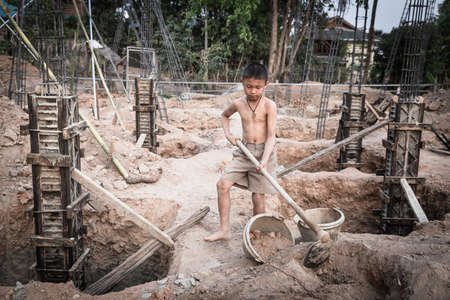 boys labor work in the construction site,  Against child labor, Poor children,  construction work, Violence children and trafficking concept