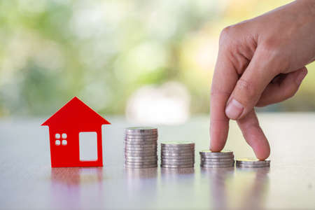 planning savings money of coins to buy a home, concept for property ladder, mortgage and real estate investment. for saving or investment for a house Stock Photo