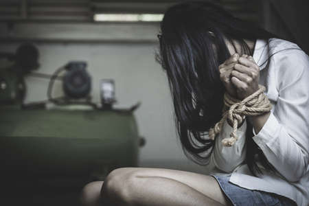 The slave woman is tied with a rope, stop acts of violence against women, rape and abuse, human trafficking, Imagens