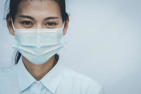Doctor wearing protection face mask against virus.