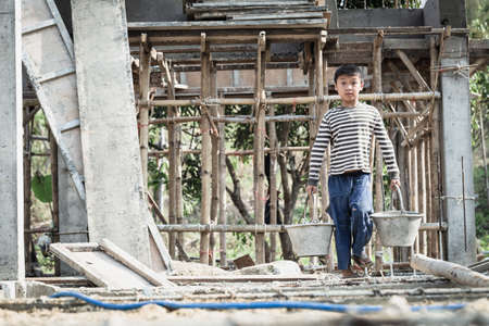 Poor children are forced to work construction, Violence children and trafficking concept,Anti-child labor, Rights Day on December 10.