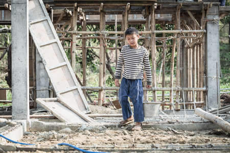 Children working at construction site for world day against child labor concept, Poverty, Human trafficking.