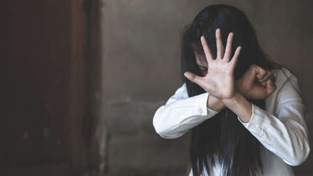 woman raised her hand for dissuade, The concept of sexual harassment against women and rape, stop violence against Women,sexual abuse, human trafficking, domestic, international women's day.