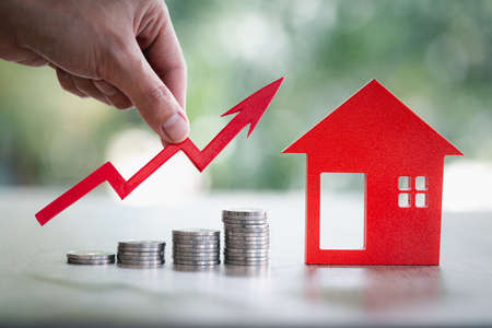 Businessman Holding  Graph Over The Increasing House Miniature. Property investment and house mortgage financial concept, Investment property, Real estate, Saving money.