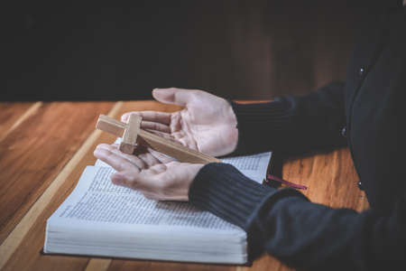 woman hands praying to god with the bible. Woman Pray for god blessing. Religious beliefs Christian life crisis prayer to god. Фото со стока