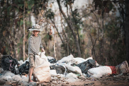 Poor children collect garbage for sale because of poverty, Junk recycle, Child labor, Poverty concept, World Environment Day,