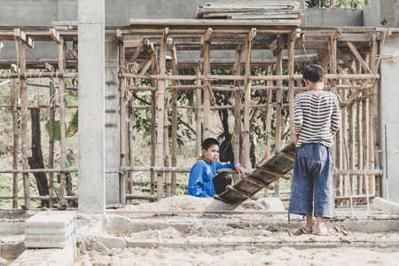 Children working on construction sites,  Poor children, poverty, Child labor, human trafficking, World Day Against Child Labour concept. Фото со стока