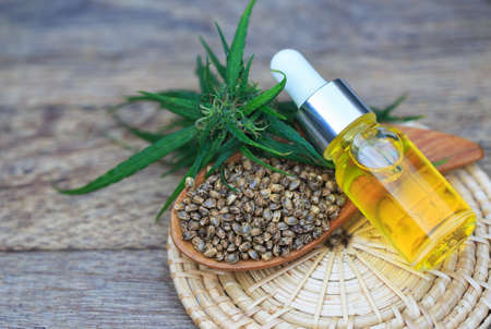 CBD oil hemp products, Medicinal cannabis with extract oil in a bottle. Medical cannabis concept Фото со стока