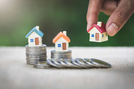 Investors hold houses.  Real estate,  Property investment and house  Mortgage concept.
