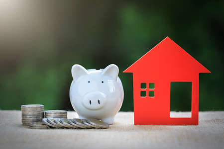 Saving money for real estate with buying a new home and loan. Choosing the right real estate property